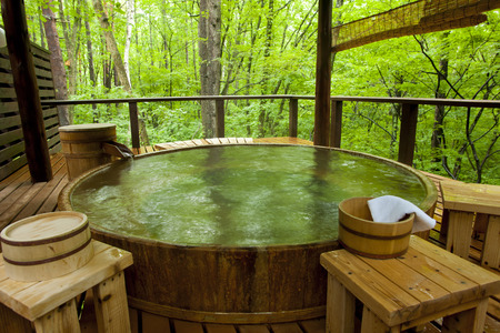 openair: Open-air bath in the woods Stock Photo
