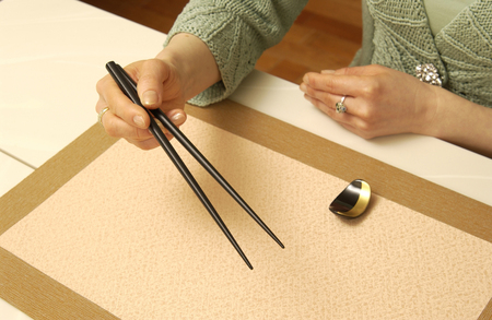 manners: Manners of chopsticks Stock Photo