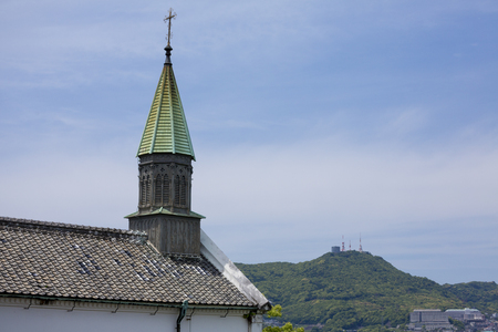 cultural artifacts: Oura Catholic Church and mount inasa