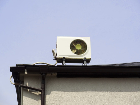 Air conditioner outdoor unit that was installed on the roof of a house