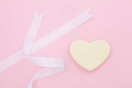 heartshaped: Ribbon and heart-shaped chocolate