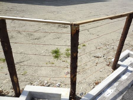 vacant land: Wooden fence of a vacant lot Stock Photo