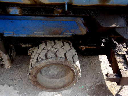 heavy equipment: The wheels of the asphalt laying for the heavy equipment of road construction