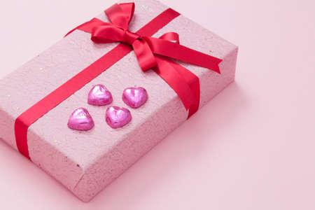 heartshaped: Red gift box and a heart-shaped chocolate Stock Photo