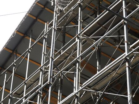 Wooden building construction scaffolding Foto de archivo