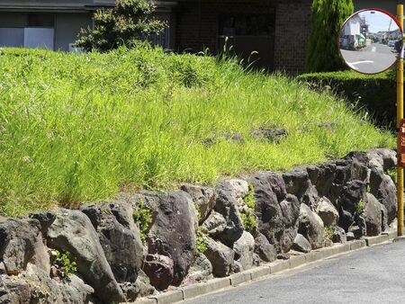 housing lot: Stone wall of the house of a vacant lot Stock Photo