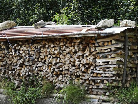 stored: Firewood that was stored in the mountain Stock Photo