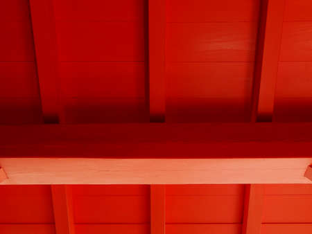 crimson colour: Wooden building painted in red