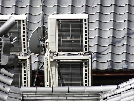 Air conditioner outdoor unit on the roof Banco de Imagens