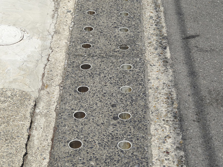 footway: Groove of the lid that opened the sidewalk hole