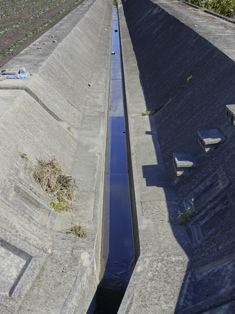 developed: Agricultural irrigation canals that have been developed in the concrete Stock Photo