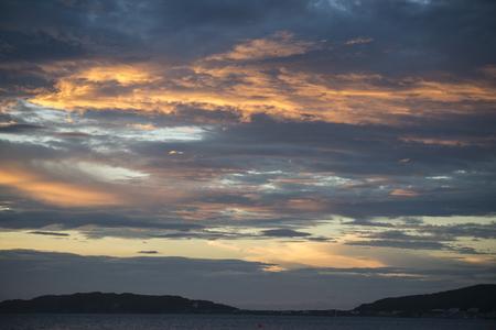 the setting sun: Clouds shining in orange lit by the setting sun Stock Photo