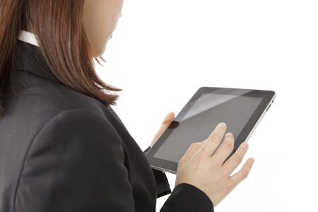 new employee: From behind a new employee with a tablet PC
