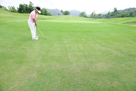 Men who play golf 写真素材