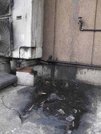 Oil contamination of the air conditioner outdoor unit Banco de Imagens