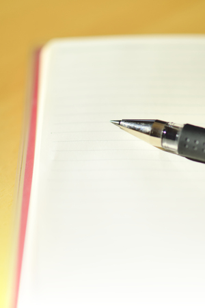 pocketbook: Pocketbook and the ballpoint pen Stock Photo