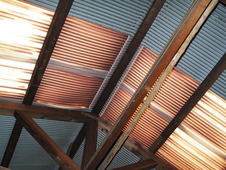 depreciation: Vinyl tin of degraded warehouse roof