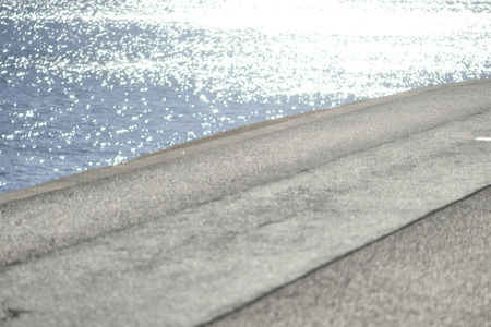 scintillation: Water surface sparkle and promenade Stock Photo