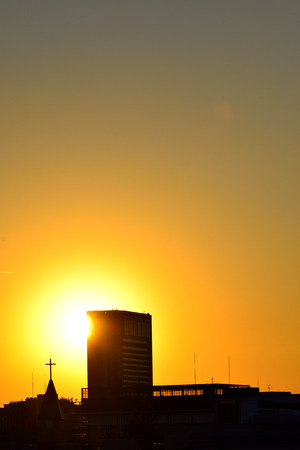 the setting sun: The Cross of the setting sun and the building and the church