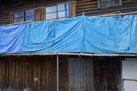deserted: Deserted house blue sheet of
