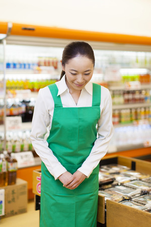 shopping buddies: Female clerk of super to the bow Stock Photo