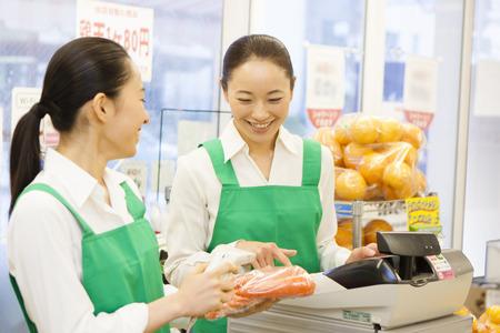 Women clerks stand cashier