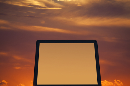 liquid crystal display: Laptop and sunset Stock Photo