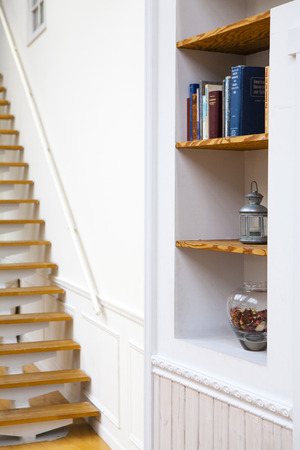 a detached living room: Bookshelf and stairs