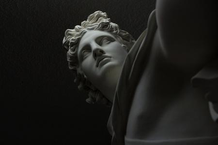 contrasting greek roman statue