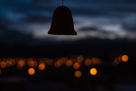 bell with unfocused background of a sunset