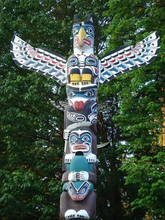 the totem pole: Indian painted totem poles in Stanley Park, Vancouver Canada Stock Photo