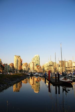 amazing stunning: Buildings and boats reflected in water near English Bay Stock Photo