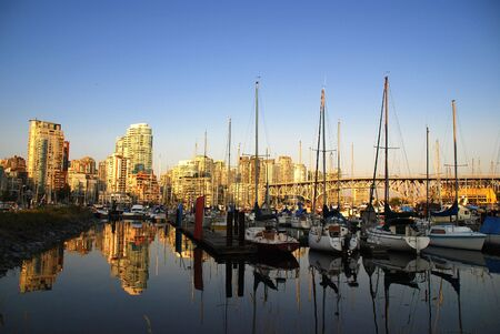 Summer landscape with buildings and boats in English Bay, Vancouver Canada photo
