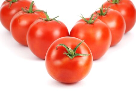 Fresh tomatoes made of the word V photo