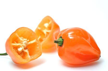 Isolated fresh hot pepper called habanero Stock Photo