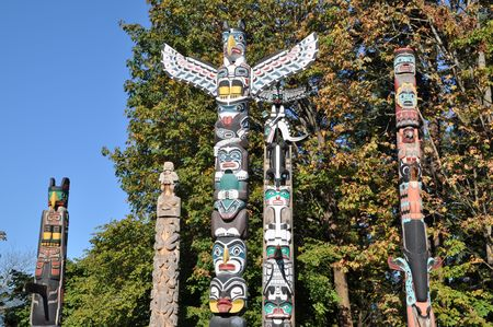 totem: em shaped in Stanley park, BC Canada  Stock Photo
