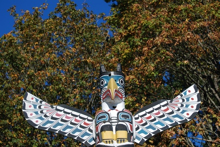 Close-up Totem shaped in Stanley park, BC Canada  photo