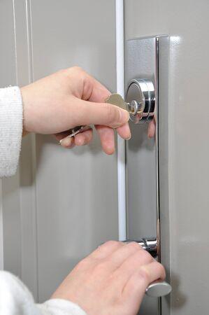 Unlocking the door  Stock Photo - 8549175