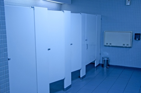 Public washroom stall with blue tone