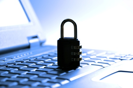 Secured your laptop; with blue tone Stock Photo - 8764443