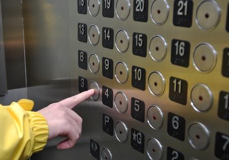 people in elevator: Elevator Interior