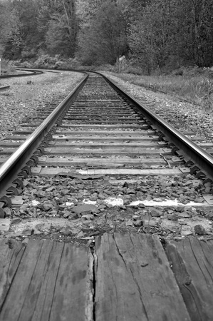 Macro railroad track with black and white image  photo