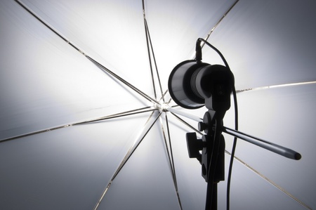 Photography set up with umbrella reflecting modeling lamp photo