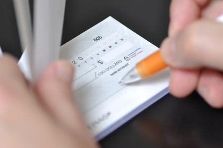 Prepare writing a check  Banco de Imagens