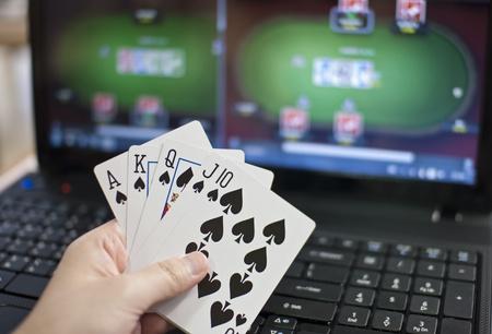 betting: Woman holding royal flash card Stock Photo