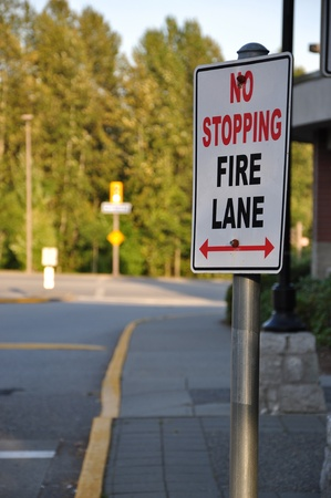 dissuade: No stopping on fire lane sign Stock Photo