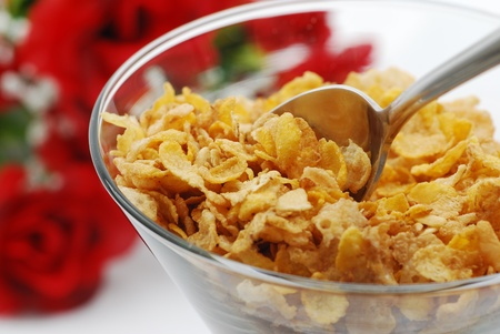 corn flower: Eating fiber cereal with rose background Stock Photo