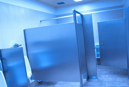 Public washroom stall with blue tone  photo
