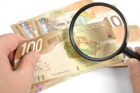 canadian currency: Magnifying glasses with Canadian Dollar