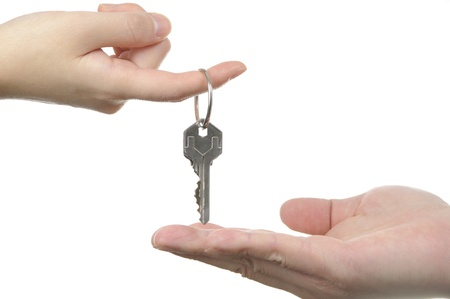 Human hands and key isolated on white background Stock Photo - 11194856